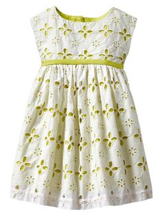 Eyelet dress with contrasting lining. Geranium pattern?