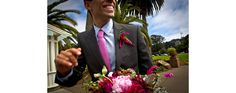 Best man displays lovely florals during a wedding at the Conservatory of Flowers. By Janine Mapurunga. San Francisco, 2010.