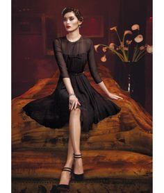 Итальянский бренд Max Mara представил новые фото рекламной кампании осень-зима 2012/13. MaMara Elegante представляет модель Ming Xi