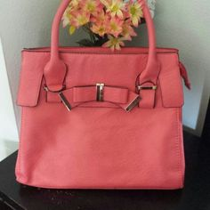 Cute Pink Purse I am reposhing this. It's in great condition, I'm just done using it. It also has a detachable and adjustable strap that comes with it. It has a zipped pocket in the back and inside. Has 2 additional pockets inside. Kate Hill Bags