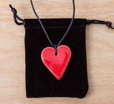 accessorise your spring wardrobe with this pretty, handmade heart necklace...