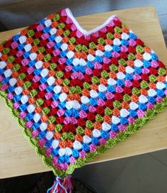 Child's poncho - I totallly want to try this.