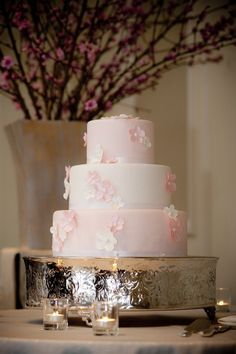 I know it depends somewhat on the season, but I love the idea of incorporating cherry blossoms into the decor (or cake!). I don't think I could pull off a full-blown Japanese style wedding, but since I lived a year in Japan, having small Japanese touches would be meaningful for me.