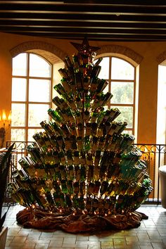 Ive found what to do with all our empty wine bottles brittany!!!! Wine Bottle Christmas Tree!!!