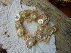 Boho cuff with vintage buttons and cream with by MJsflowerfield
