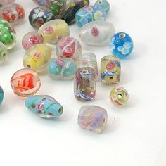 50 grams - (HUGE LOT) of Glass painted beads: http://www.outbid.com/auctions/16865-everything-goes#48