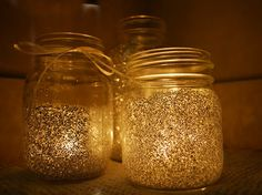 Fairy light—Apply a thin layer of Mod Podge to the container of choice, pour in glitter, shake it up, tip upside down to let excess glitter drop, let dry and add a candle or light bulb