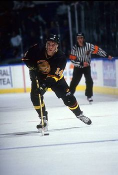 Geoff Courtnall of the Vancouver Canucks skates with the puck during an NHL  game against the 92a5feef2