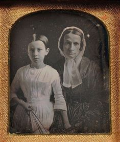 The girl is slightly foward as the primary figure in the image. She is the purpose of this daguerreotype, but what is most striking is how worn the mother seems. It is impossible not to care. The girl's dress is lovely and timeless, and the way mamma is holding her hand is also lovely and timeless. It is almost as if she is presenting her daughter. I can think of many things that mamma's fan in her daughter's hand might symbolize.