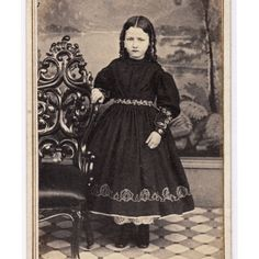 1860s -  Studio portraiture of a young girl shown in full standing portrait.  Girl clothed in a dark print dress with full and bell-like crinoline skirts. Her pantalettes peek out from beneath the hem of her dress.  A very fine portrait of a Civil War child and 1860s children's period fashion. Photographer is advertised ~ signed: M. A. Kleckner of Bethlehem, Pennsylvania. PA Ebay: Horsesinparadise