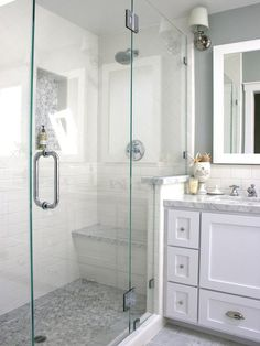 Love colors and finishes. Marble Glass-Enclosed Tiled Shower with Niche and White Vanity - on HGTV