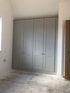 These dove grey ash embossed Fitted Wardrobes features our lovely rugby handles. The cornice finished off the angled ceiling perfectly. wardrobe Shaker Fitted Wardrobes by Simply Fitted Wardrobes Bedroom Built In Wardrobe, Fitted Bedroom Furniture, Bedroom Closet Doors, Fitted Bedrooms, Wardrobe Design, Build In Wardrobe, Wardrobes For Bedrooms, Grey Cupboards, Built In Cupboards