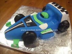 Homemade Formula 1 Car Birthday Cake: I made this Formula 1 Car Birthday Cake from Debbie Browns Easy Party Cakes.  I followed all the instructions. Use a 10inch square cake tin.  Trim off