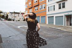 San Francisco street style in a black wrap skirt