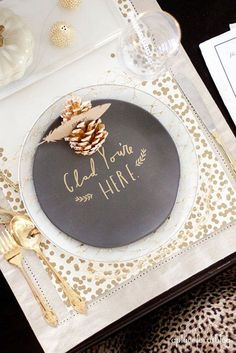 Decorate place settings with gold adornments like napkins, utensils and little charms!