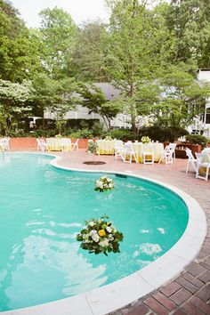 Pool Wedding Ideas pool backyard wedding decorations with large round tables and small upholstery chairs also large tent Real Weddings Courtney Michaels Backyard Poolside Wedding