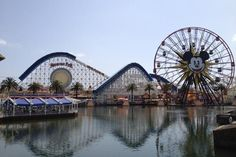 Disneyland--sooooo want to go on this ferris wheel..how pretty on the water!!
