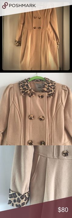 ***NWOT*** Asos Coat This gorgeous coat is so stylish and on trend with leopard print detail. It has never been worn and is made of perfect 59% wool and 41% viscose making it super warm! There is an extra button that comes with it. You will love this coat from Asos!  ASOS Jackets & Coats