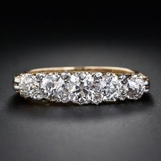 This jeweler used teeny tiny rose cut diamonds to fill in the gaps between the larger stones and the result is wall to wall sparkle!  - Lang Antiques