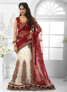 Sensible colors and excellent designs and romantic moods are reflected with an alluring style. Make the heads turn the moment you dress up with this desirable maroon and off white net a line lehenga c...