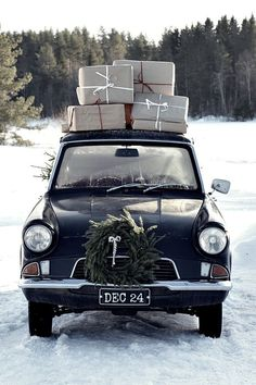 driving home for Christmas | vintage beetle chair with holiday presents on the roof and a Christmas wreath on the hood | snowy forest landscape