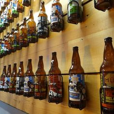 I love this idea! 22 oz beers displayed in bike water bottle holders. | Yelp