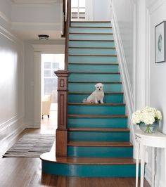 Go For A Gradient | Stair risers are a completely unexpected showcase for colour, which makes this entryway that much more fun. The ombré effect isn't hard to achieve: simply take your shades in order from one paint strip and paint at least two risers in each colour. | Photographer Jonny Valiant | #HHplayfuldesign #staircase