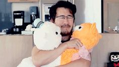 Have you seen anything so adorable and so amazing? Markiplier is cuddling lamas