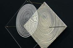 'Spirale' (1955) by Venezuelan op and kinetic artist Jesús Rafael Soto (1923-2005). Painting on wood, plexiglas, metal, 30 x 30 x 28 cm. via Le Monde