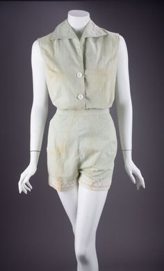 """Summer outfit consisting of a green and white striped seersucker sleeveless shirt, with a small pointed collar, three-button front closure (one button absent), together with matching shorts trimmed in lace, interior labels in both read, """"Koret of California/ Sportswear Division/ Washable/ Made in U.S.A. From the personal property of Marilyn Monroe."""