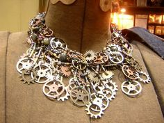 Someone got very creative...old gears, watch parts and clock mechanisms turned into a very funky necklace. Love it.