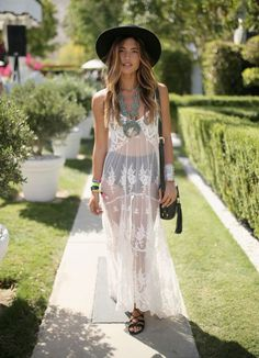 A lace dress worn over shorts and sandals is the perfect festival look.