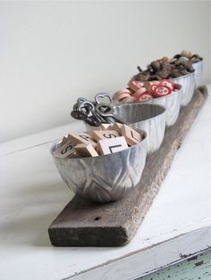 love this idea--available on etsy...  vintage jello molds (could use tart tins too) into an organizer!