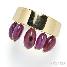 18kt Gold and Ruby Ring, the polished gold band suspending a fringe of five ruby beads