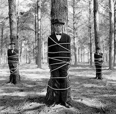 Rodney Smith Photography How neat would it be to do this to groomsmen and the groom and have the women tie them up?!