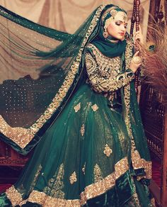 Outfit by Je Roche Fashion House | Photo by Sofia | Makeup by Asian Creations | How stunning is this hijaabi bride? Love the emerald green and gold duo.