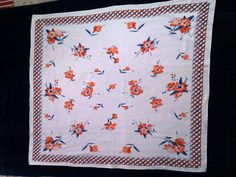 vintage tablecloth- would be a great quilt top and just sew tufts of embroidery floss through the center of each flower and throughout the border.