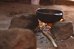 If you plan to cook food over a campfire, making the cook fire inside a fire pit is the safest method. A fire pit lessens the chances of starting a brush or forest fire.