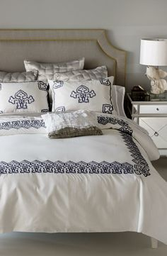 Adoring the elegance and blue embordered designs on the bed set | Blissliving Home Bedding Collection
