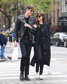 The couple that dresses together: Dakota Johnson and Matthew Hitt were seen arm in arm strolling through NoHo in New York on Monday