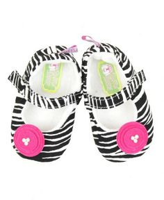 Bold and beautiful in our zebra print, these fuchsia-accented shoes will put a smile on your little one's face! Designed to mix-n-match with an array of items in the RuffleButts Apparel Collection, this the perfect addition to her ruffled wardrobe.  RuffleButts Zebra Soft Soled Shoes | www.RuffleButts.com