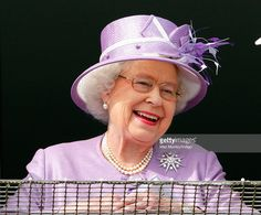 Queen Elizabeth II watches the racing as she attends Derby Day of the Investec Derby Festival at Epsom Racecourse on June 7, 2014 in Epsom, England.