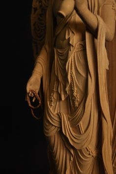 the detail of Juichi-men Kannon wooden statue, made by SAKURAI Kakuzan, Japan 櫻井覺山