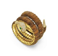 A wood, diamond and emerald snake bracelet #christiesjewels
