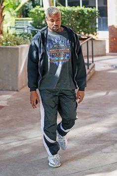 Kanye West wearing  Reebok Track Pants, Vintage 1990s Chrome Sweet Chrome T-Shirt, Adidas Yeezy Boost 350 V2 zebra