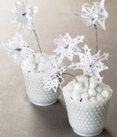 materials White paper Scissors Silver pipe cleaners Small pretty pots Pebbles Cotton balls instructions 1 Layer two or three snowflakes. Snowflake Centerpieces, Snowflake Decorations, Christmas Party Decorations, Holiday Crafts, Christmas Crafts, Snow Crafts, Winter Decorations, Centerpiece Ideas, Holiday Ideas