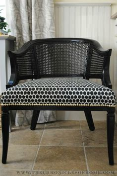 Vintage cane chair redone with black and white and brass nailheads