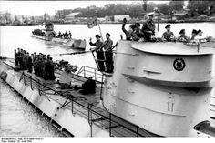 8 June 1941, U-Boots U-123 and U-201 leaving port to go on war patrol with their crews on deck waving