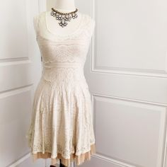 Free People Lace Overlay Dress This dress is so pretty and classic! I wore this once for my bridal shower so it is in great condition! The material is soft and stretchy and has a lining underneath and a bit of tulle at the bottom. Free People Dresses Midi