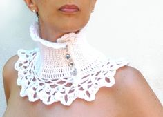 """Funky, precious and stylish... this neckwarmer is the right accessory to add to your autumn/winter wardrobe... this little and soft crocheted capelet is the perfect addition with any sort of look... wear it with your jeans or with a more elegant outfit!  Made out of white wool yarn, """"Ninu'"""" has a solid turtle neck with a little ruffled neckline and a crocheted fine lace collar... it will give a new stylish look to your favourite crew neck sweater, jumper or blouse.  Four sparkling rhinestone"""